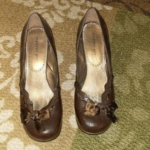 Brown heels with flower and bow detail